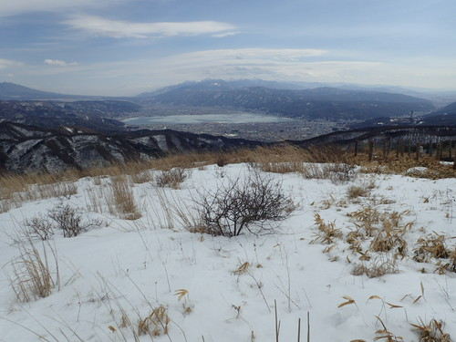 山頂から見る諏訪湖と南アルプス